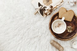 Cozy winter flat lay background, cup of coffee, old vintage paper on white background. Still life trendy composition for bloggers