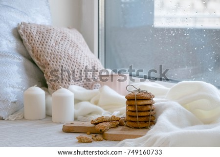 cozy winter still life: warm woolen knitting, hot tea, red book, Christmas cookies and music. Headphones. Hygge style. Cozy winter home morning holiday. Soft photo #749160733