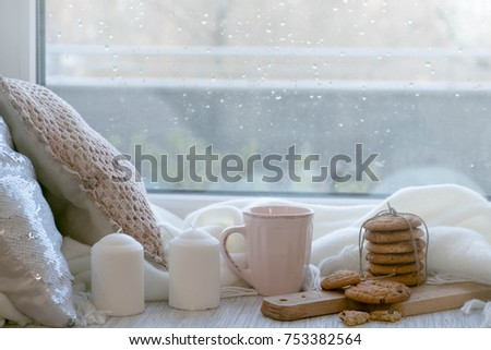 cozy winter still life: warm woolen knitting, hot tea, red book, Christmas cookies and music. Headphones. Hygge style. Cozy winter home morning holiday. Soft photo #753382564