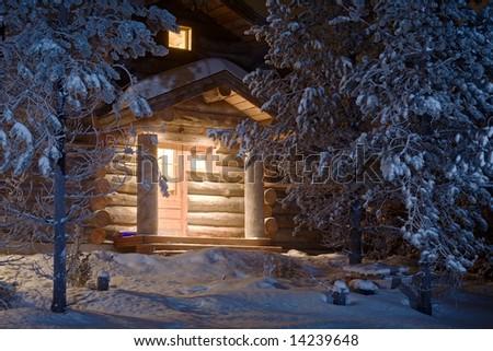 cozy wooden cottage in dark winter forest