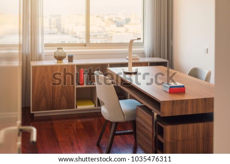 Cozy work space in flat with desk, chair and window. Cabinet room, home office