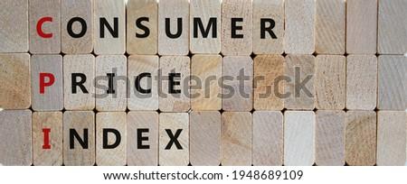 CPI, consumer price index symbol. Wooden blocks with words 'CPI, consumer price index'. Beautiful wooden background, copy space. Business and CPI, consumer price index concept. Stock fotó ©