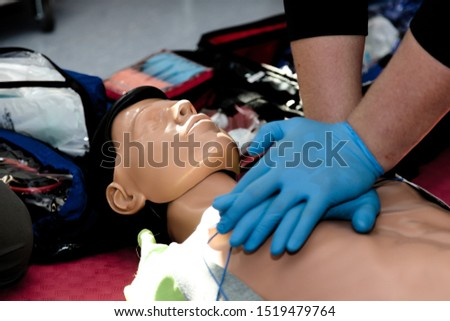 CPR training on a dummy #1519479764