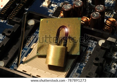 Stock Photo CPU computer processor over motherboard with padlock. Data security concept