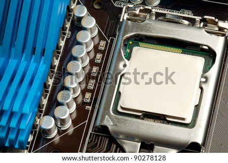 cpu in the socket on motherboard - stock photo