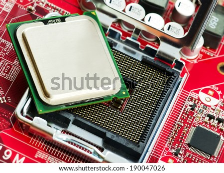 CPU socket and proccesor close up image.
