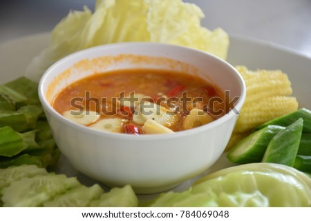 Crab eggs paste served with vegetables. #784069048