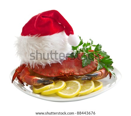 Crab in Santa Claus hat on a platter