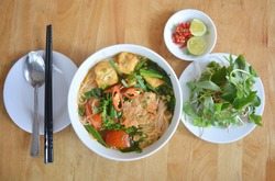 Crab paste vermicelli soup with tofu and vegetables on white bowl, Rice noodles with paddy field crab paste