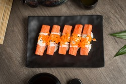 Crab sticks Sushi Japanese Food Style, Crab sticks Sushi roll on the table.