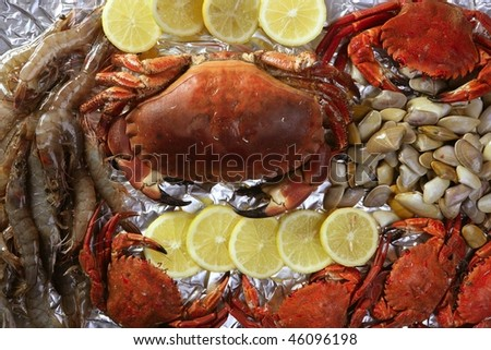 Crabs tellin shrimp clams and lemon seafood still life
