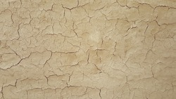 crack and surface texture of dry soil ground in full frame, abstract background, beauty in nature
