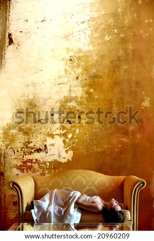 crack background and woman on sofa