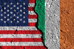Crack between America and Ireland flags. political relationship concept