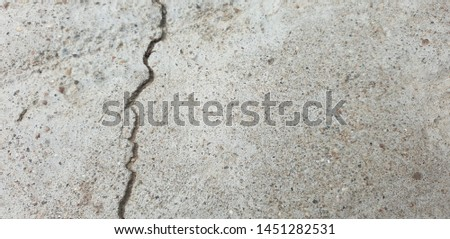 Crack in concrete. Cracked foundation. Cracked road. #1451282531