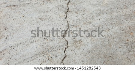 Crack in concrete. Cracked foundation. Cracked road. #1451282543