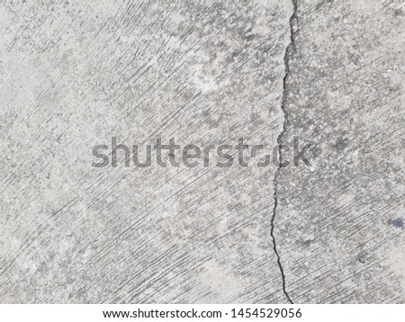 Crack in concrete. Cracked foundation. Cracked road. #1454529056