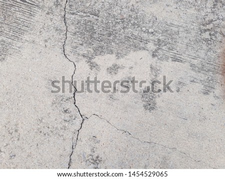 Crack in concrete. Cracked foundation. Cracked road. #1454529065