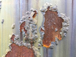 Cracked and peeled metal with rust texture