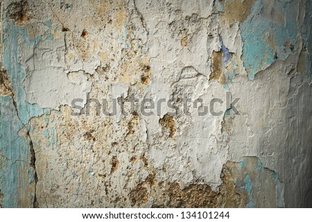 cracked and peeling paint and grunge old wall with texture