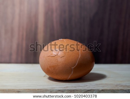 cracked boiled egg on the nature wooden table #1020403378