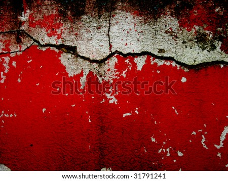 cracked bright red and white wall