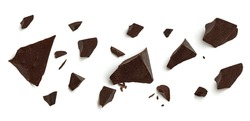 Cracked broken chocolates, chocolate chips morsels or chocolate parts from top view isolated on white background