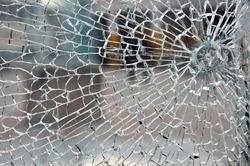 Cracked broken destroyed glass damaged window background