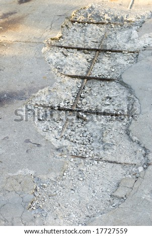 Cracked cement of a street on a sunny day.