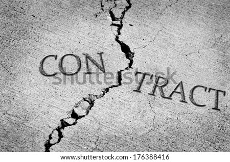 Cracked cement symbolizing a broken or breached contract
