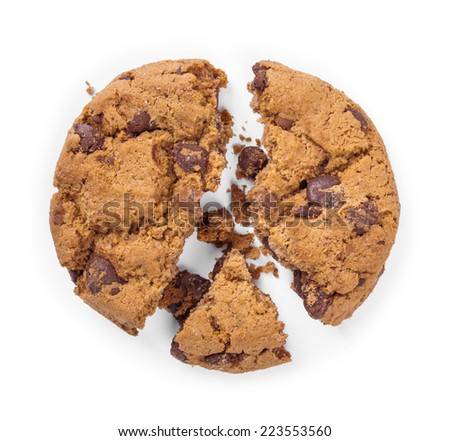 Cracked chocolate chip cookie isolated on white background