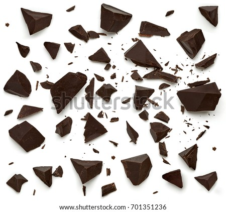 Cracked chocolates / broken chocolate chips or chocolate parts top view isolated on white background