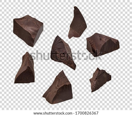 Cracked chocolates / broken chocolate chips or chocolate parts top view on isolated background including clipping path