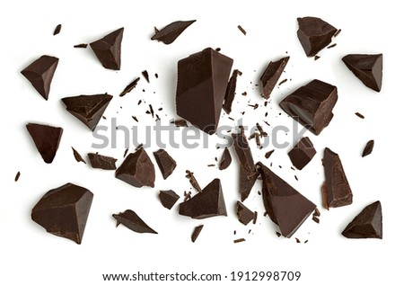 Cracked chocolates or broken chocolate chips or chocolate parts from top view isolated on white background