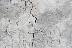 Cracked concrete. Concrete texture with cracks. Gray asphalt. The old texture is broken.