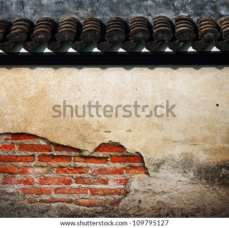 cracked concrete vintage brick wall background with china roof