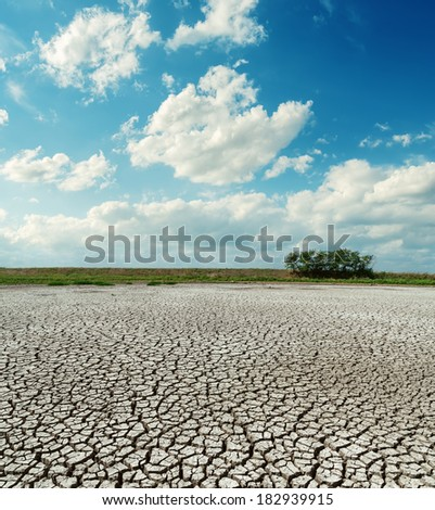 cracked desert under low clouds