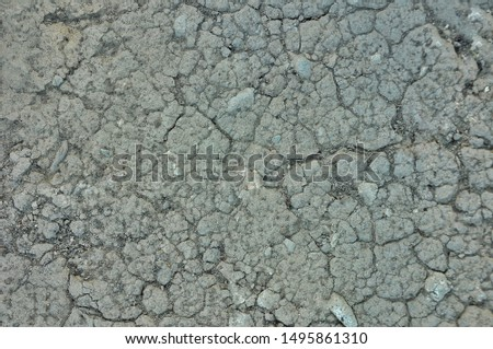 Cracked earth, cracked soil. texture of grungy dry cracking parched earth. Global worming effect.  #1495861310