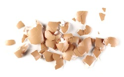 Cracked eggshell pile, crushed egg shells isolated on white background, top view