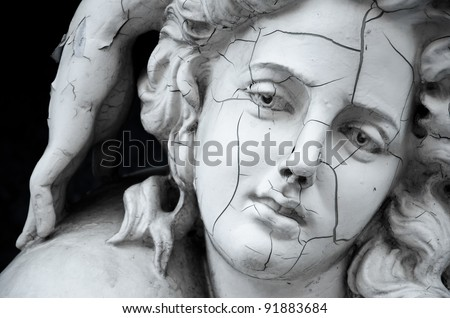 Cracked face of female traditional sculpture at ABAC university, Thailand