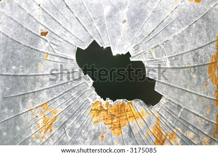 cracked glass with black hole in the middle