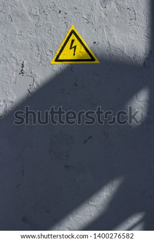 cracked gray paint with perceiving yellow triangle icon #1400276582