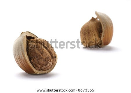 Cracked Hazelnuts isolated on white background