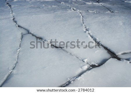 Cracked ice, on a large water body