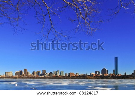 Cracked ice on frozen Charles river with Boston skyline background