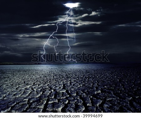 Cracked land and the lightning bolts - stock photo