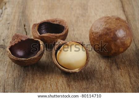 cracked macadamia on wood background