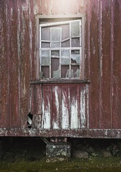 Cracked old windown in a wood house