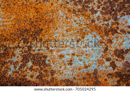 Cracked paint on an old metallic surface background, Sheet of rusty metal with cracked and flaky paint