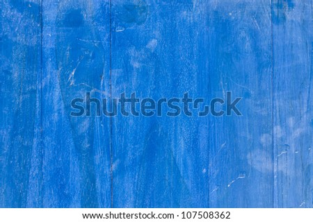 Cracked paint on blue wooden surface